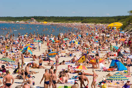affluence: PALANGA, LITHUANIA - JULY 26: Affluence of holidaymakers to Palanga beach on July 27, 2008 in Palanga, Lithuania. About 1 million people visited Baltic coast over the weekend.