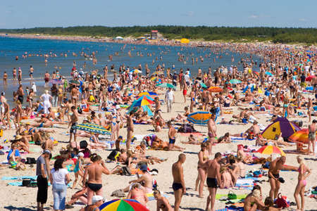 PALANGA, LITHUANIA - JULY 26: Affluence of holidaymakers to Palanga beach on July 27, 2008 in Palanga, Lithuania. About 1 million people visited Baltic coast over the weekend.