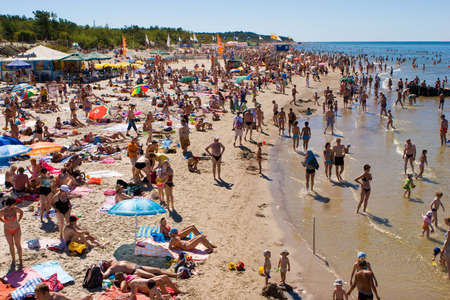 baltic people: PALANGA, LITHUANIA - JULY 26: Affluence of holidaymakers to Palanga beach on July 27, 2008 in Palanga, Lithuania. About 1 million people visited Baltic coast over the weekend.