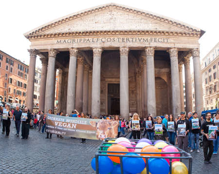 2nd century: Rome - November 1: Vegans hold posters on World Vegan Day in front of the Pantheon on November 1, 2013 in Rome, Italy. Pantheon is a famous monument of ancient Roman culture, the temple of all the gods, built in the 2nd century. Editorial