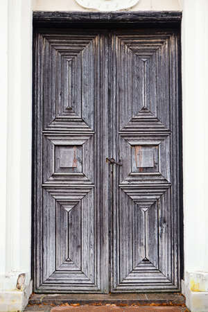 Old medieval wooden door of the building in Kernave, Lithuania photo