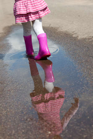 mud girl: Little girl in a puddle