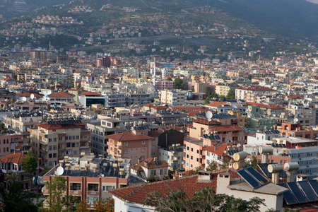 Cityscape with sollar thermal collectors for water heating on the roofs of Alanya, Turkey photo