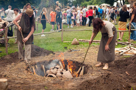 archaeology: KERNAVE, LITHUANIA - JULY 5: Visitors and craftsmen at 11th International Festival of Experimental Archaeology Days of Live Archaeology on Jul 5, 2009 Editorial