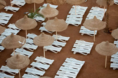 sunshades: Recreational industry: sunloungers and sunshades on the beach