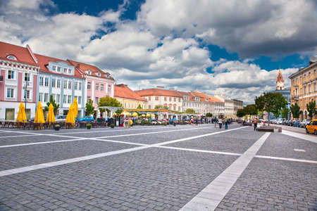 town hall square: VILNIUS, LITHUANIA - AUGUST 25: People walking and attending street cafes on August 25, 2010  in Town Hall Square, Vilnius, Lithuania. This place is the main square of capital city, near to Town Hall building.