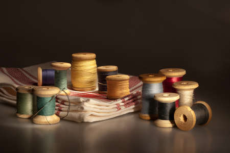Still life with multicolored cotton thread spools photo