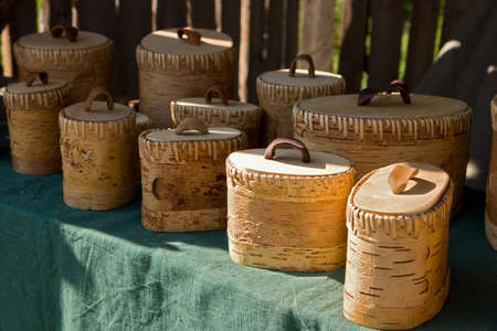 birchbark: Boxes with lids made from birchbark, traditional handmade souvenirs from crafts fair in Kernave, Lithuania.