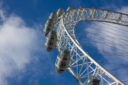 millennium wheel: London, UK - January 30, 2015: Tourists in the capsules of London Eye looking at panorama of the city on Jan 30, 2015. Millennium Wheel is a giant Ferris wheel situated on the bank of the River Thames in London.