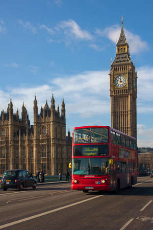 double decker: London, UK - January 30, 2015: Double Decker Bus, most iconic symbol of London, and Big Ben in far behind on Jan 30, 2015 in London, UK.