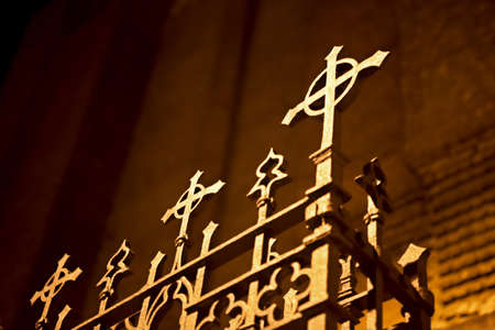rusty fence: Rusty fence of a church with crosses at night Stock Photo