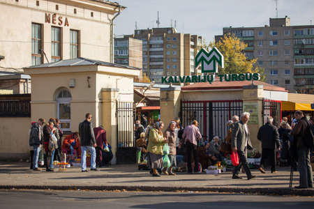 marketers: Vilnius, Lithuania - October 11, 2014: Marketers sell goods around the entrance of Kalvariju market on October 11, 2011 in Vilnius, Lithuania. Kalvariju market is the main market in Vilnius. Editorial