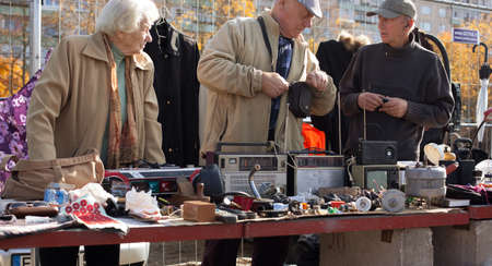 fleamarket: Vilnius, Lithuania - October 11, 2014: The elderly are selling antique goods in a flea market in Kalvariju marketplace on October 11, 2014 in Vilnius, Lithuania. Editorial