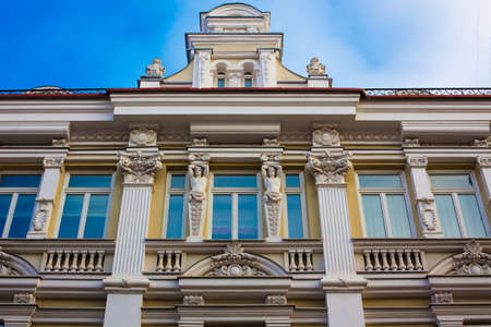 atlantes: Building with the classical European architectural elements  atlantes and balustrades Vilnius Lithuania. Didzioji st 10 House of University Cliinics Palace of Gostautai