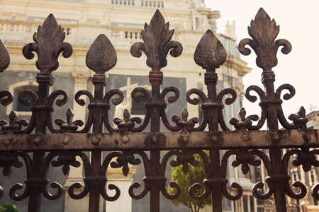 Fence detail in the Piazza del Duomo with the Cathedral of Santa Agatha in Catania Sicily Italy photo