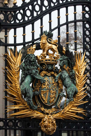 Royal Crest at Buckingham Palace Gate in London United Kingdom