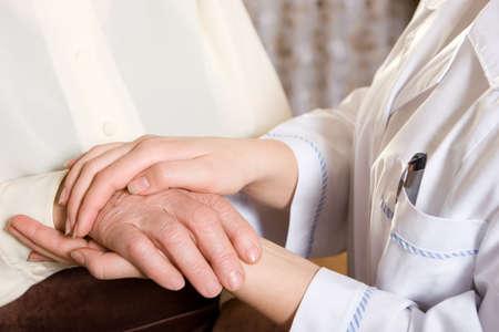 social care: Nurse or social worker cares about senior woman