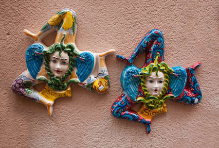 region sicilian: Ceramic souvenirs triskelions from Sicily, Italy. Triskelion is a symbol of Sicily.