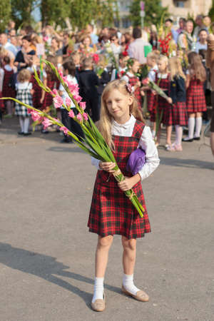 schoolboys: Vilnius, Lithuania - September 1, 2015: Schoolgirls and schoolboys came to the school for the first time. They watch some festive event on September 1, 2015 in Vilnius, Lithuania.