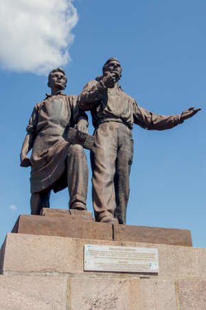 controversial: Vilnius, Lithuania - May 9, 2015: Controversial soviet statue Industry and Construction by Bronius Vysniauskas and Napoleonas Petrulis was built on the Green bridge in Vilnius, Lithuania. Sculptures were removed in July 2015. Editorial