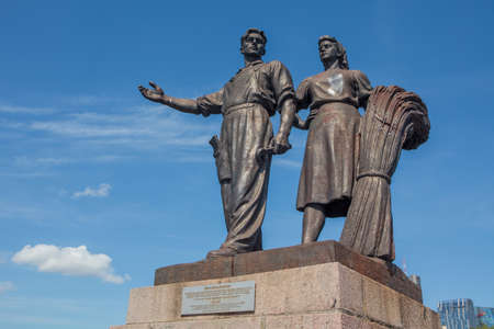 realism: Vilnius, Lithuania - May 9, 2015: Controversial soviet statue Agriculture by Bernardas Bucas and Petras Vaivada was built on the Green bridge in Vilnius, Lithuania. Sculptures were removed in July 2015.