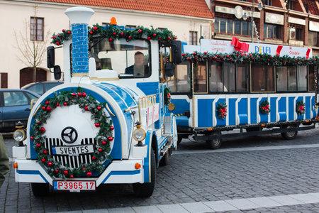 christmas train: Vilnius, Lithuania - December 27, 2015: Christmas train is ready to make a trip around Vilnius old town in Vilnius, Lithuania on 27 December, 2015.