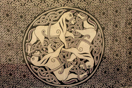Celtic ornament of three horses on the fabric. Ancient symbol of Epona, celtic goddess of horses Stock Photo