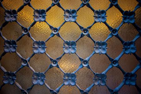 ironwork: Window detail with ironwork grid, flower ornament