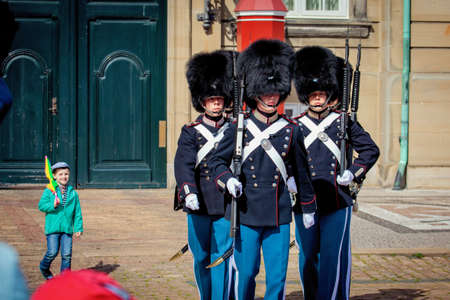 honour: Copenhagen, Denmark - July 29, 2015: The guards of honour march along the square near the Royal residence Amalienborg Palace in Copenhagen.
