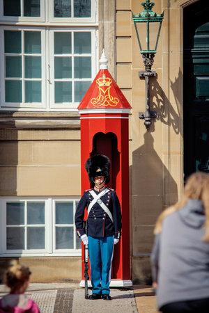 honour: Copenhagen, Denmark - July 29, 2015: The guard of honour mounts guard near the Royal residence Amalienborg Palace in Copenhagen.