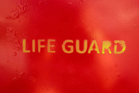 life guard stand: Text Life Guard sprayed a the wall of a life guard stand on a beach or pool Stock Photo