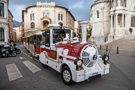 trackless: Monaco - November 4, 2016: Red and white trackless train for sightseeing on the street of Monaco near the Cathedral. Editorial