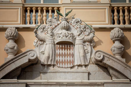 princely: Architectural detail with Monaco coat of arms - Royal Arms of Prince Albert II, monarch and head of Princely House of Grimaldi, Monaco Stock Photo