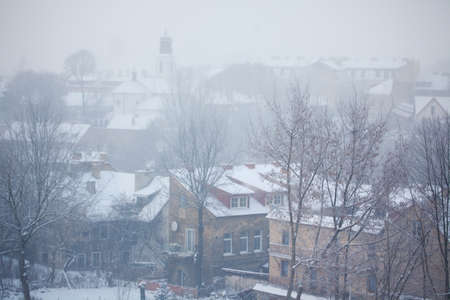 dull: Dull and foggy winter day in Vilnius old town, Lithuania