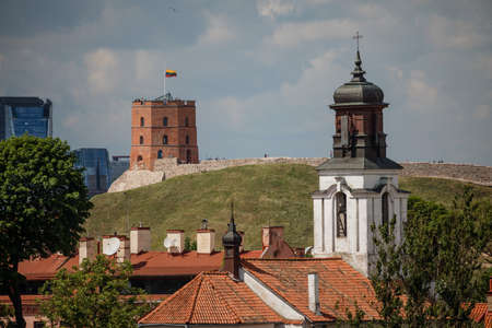 Vilnius old town cityscape with Gediminas castle and modern office buildings, Lithuania Editorial