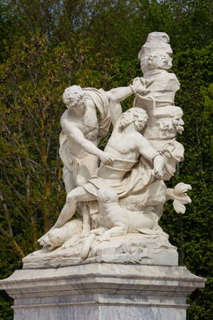 Versailles, France - April 13, 2014: Marble statue in the park of Palace of Versailles, France