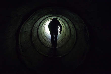 Life after death concept, the light at the end of the dark tunnel Stock Photo