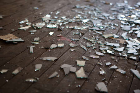 Pieces of shattered glass or mirror in an abandoned house