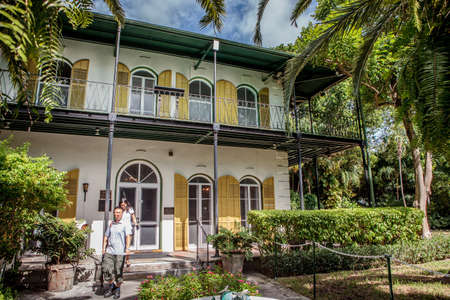 Key West, Florida, USA - October 6, 2017: Tourists visit the Hemingway House, the home of famous author Ernest Hemingway, which is now a museum. Editorial
