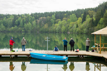 Vilnius, Lithuania - May 19, 2017: Fishermen are fishing on the Zalieji Ezerai (Green Lakes) in Vilnius, Lithuania.