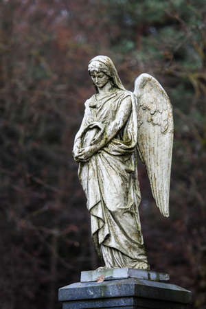 Statue of mourning angel in some lithuanian cemetery, Lithuania
