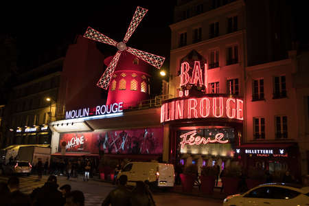 Paris, France - October 29, 2017: The Moulin Rouge in the evening. It is a famous cabaret built in 1889, locating in Montmartre district. Editorial