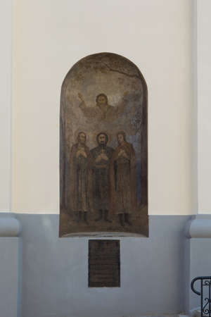 Vilnius, Lithuania - May 27, 2018: Mural on the wall of the Church of the Holy Trinity (Uniates) in Vilnius, Lithuania