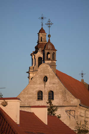 Towers of Church of St. Raphael in the evening sun, Vilnius, Lithuania Stock Photo