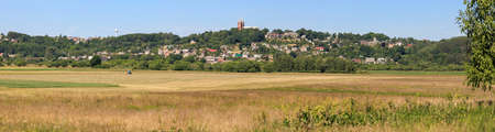 Picturesque rural landscape with crop fields and small town Vilkija on the hill. Lithuania Stock Photo