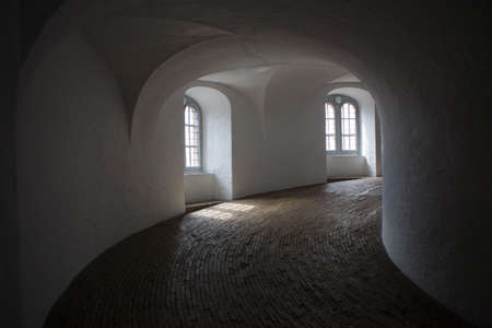 Copenhagen, Denmark - July 29, 2015: Inside view of the spiral ramp, equestrian staircase, a helical corridor leading to the top of Rundetaarn (Round Tower).