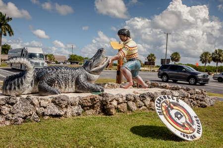 Everglades, FL, United States - October 5, 2016: Statue of alligator and Indian man in front of Miccosukee Indian Village Museum, founded in 1983