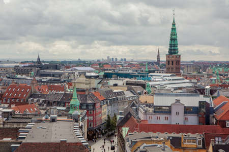 Copenhagen, Denmark - July 29, 2015: Copenhagen, the city of spires. Cityscape with Church of Our Saviour and Kunsthallen Nikolaj.