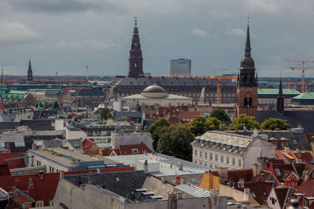 Copenhagen, Denmark - July 29, 2015: Copenhagen, the city of spires. Cityscape with Church of the Holy Ghost and Thorvaldsen Museum.