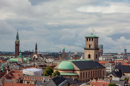 Copenhagen, Denmark - July 29, 2015: Copenhagen, the city of spires. Cityscape with Church of Our Lady and Court House.